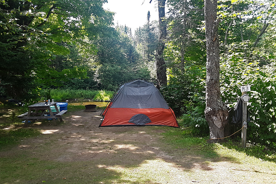 Tent on River Site at Along the River Campground & Cabins
